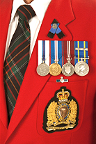 With large medals, pins and emblems