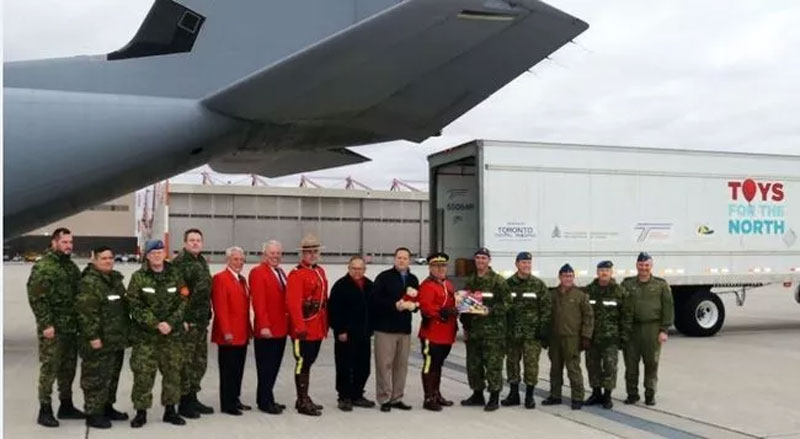 TIM MEEKS/THE INTELLIGENCER Personnel from 8 Wing Trenton, the RCMP and the RCMP Veterans Association were on hand Wednesday for a hand-over ceremony for the RCMP's Toys for the North program.