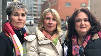 Three women who spoke out say they are devastated Toronto police will not lay sexual assault charges against a former RCMP doctor. They are Vicki Gravelle, left, Helen Henderson, centre, and Sylvie Corriveau. (Dave Seglins/CBC)